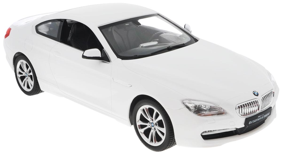 Rastar Радиоуправляемая модель BMW 6 Series цвет белый42600_белыйРадиоуправляемая модель Rastar BMW 6 Series станет отличным подарком любому мальчику! Все дети хотят иметь в наборе своих игрушек ослепительные, невероятные и крутые автомобили на радиоуправлении. Тем более, если это автомобиль известной марки с проработкой всех деталей, удивляющий приятным качеством и видом. Одной из таких моделей является автомобиль на радиоуправлении Rastar BMW 6 Series. Это точная копия настоящего авто в масштабе 1:14. Авто обладает неповторимым провокационным стилем и спортивным характером. Потрясающая маневренность, динамика и покладистость - отличительные качества этой модели. Возможные движения: вперед, назад, вправо, влево, остановка. Имеются световые эффекты. Пульт управления работает на частоте 40 MHz. Для работы игрушки необходимы 5 батареек типа АА (не входят в комплект). Для работы пульта управления необходима 1 батарейка 9V (6F22) (не входит в комплект).
