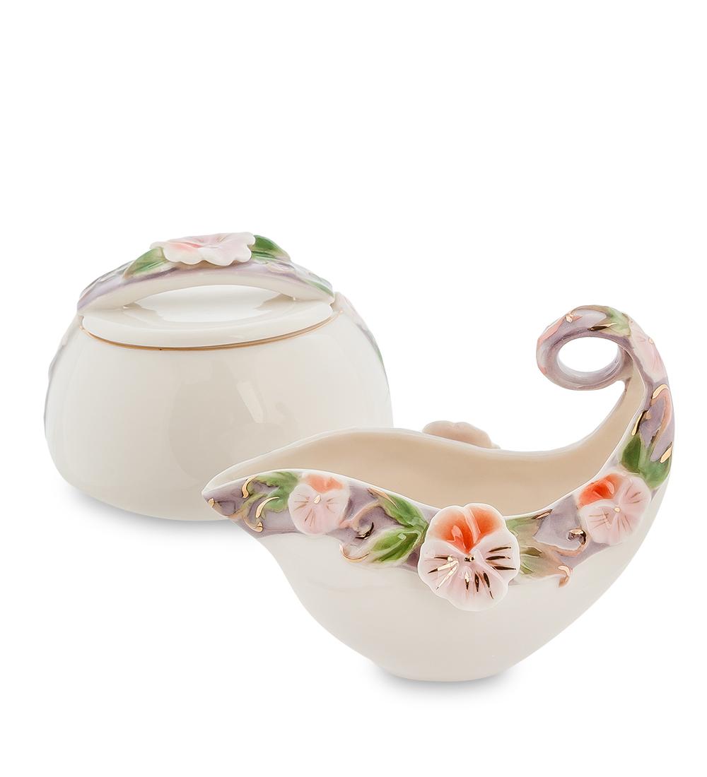 Набор Pavone Виола, 2 предмета104860Набор Pavone Виола состоит из сахарницы и молочника, изготовленных из фарфора. Предметы набора оформлены изящными объемными цветами. Набор Pavone Виола украсит ваш кухонный стол, а также станет замечательным подарком друзьям и близким. Изделие упаковано в подарочную коробку с атласной подложкой. Объем сахарницы: 200 мл. Объем молочника: 100 мл.