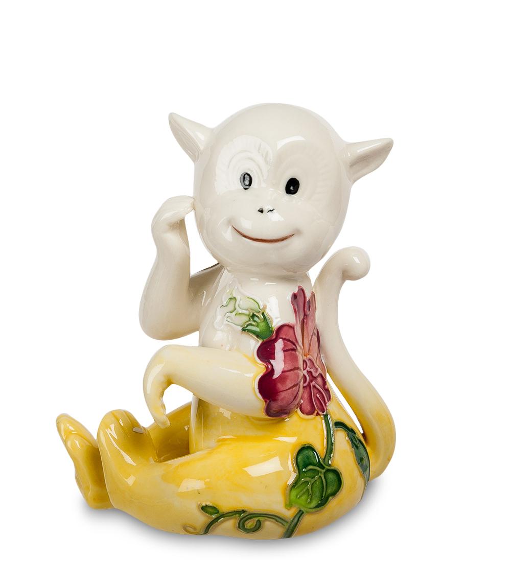 Фигурка декоративная Pavone Обезьяна, цвет: белый, желтый107437Декоративная фигурка Pavone Обезьяна станет оригинальным подарком для всех любителей стильных вещей. Сувенир выполнен из высококачественного фарфора в виде обезьянки, украшенной оригинальным узором. Изысканный сувенир станет прекрасным дополнением к интерьеру. Вы можете поставить фигурку в любом месте, где она будет удачно смотреться и радовать глаз.
