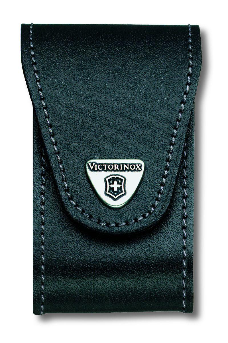 Чехол для ножей Victorinox, на ремень, цвет: черный, 10,5 см х 6 см4.0521.32Чехол Victorinox с застежкой-липучкой Velcro предназначен для переноски и хранения ножей. Выполнен из натуральной кожи. На закрывающем клапане находится металлическая фирменная эмблема компании Victorinox с изображением швейцарского креста. Изделие можно повесить на ремень при помощи специальной петли. Чехол оснащен дополнительными отделениями для фонаря и точильного камня. Длина ножей: до 91 мм. Толщина ножей: 5-8 уровней.