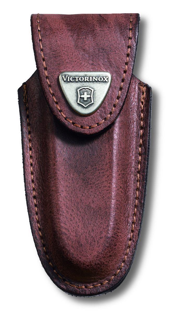 Чехол для ножей Victorinox, на ремень, цвет: коричневый, 10,5 см х 4,8 см4.0533Чехол Victorinox с застежкой-липучкой Velcro предназначен для переноски и хранения ножей. Выполнен из натуральной кожи. На закрывающем клапане находится металлическая фирменная эмблема компании Victorinox с изображением швейцарского креста. Изделие можно повесить на ремень при помощи специальной петли. Чехол оснащен дополнительными отделениями для фонаря и точильного камня. Длина ножей: до 91 мм. Толщина ножей: 2-4 уровня.