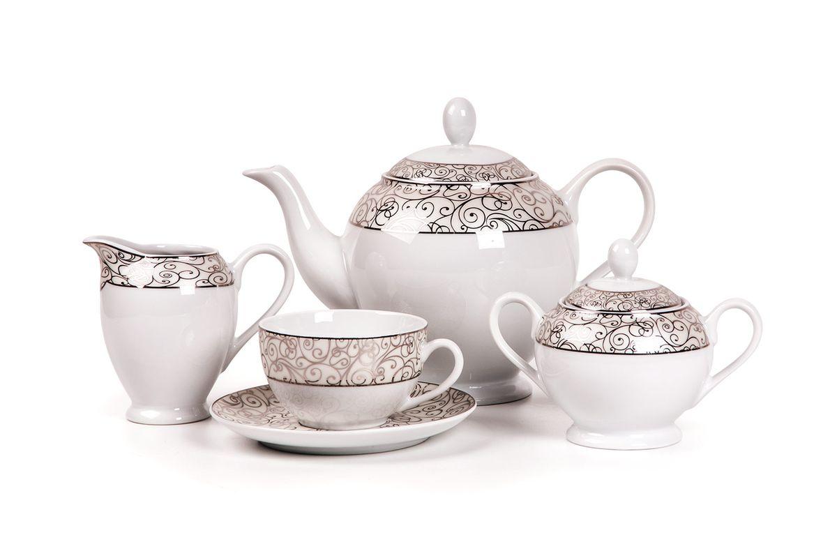 Isis 1672 сервиз чайный, 15пр, цвет: белый с платиной649509 1672Чайник 1,2л, сахарница 250мл, молочник 240мл, чайная пара 210 мл *6 штук . Фарфор фабрики Tunisie Porcelaine, производится в Тунисе из знаменитой своим качеством и белизной глины, добываемой во французской провинции Лимож.Преимущества этого фарфора заключаются в устойчивости к сколам и трещинам, что возможно благодаря двойному термическому обжигу. Европейский дизайн, декор и формы обеспечиваются за счет тесного сотрудничества фабрики с ведущими мировыми дизайн-бюро такими как: Nelly Reynal, Yves De la Rosiere, Sarah Anderson, Heracles. Материал: фарфор: цвет: белый с платиной Серия: ISIS