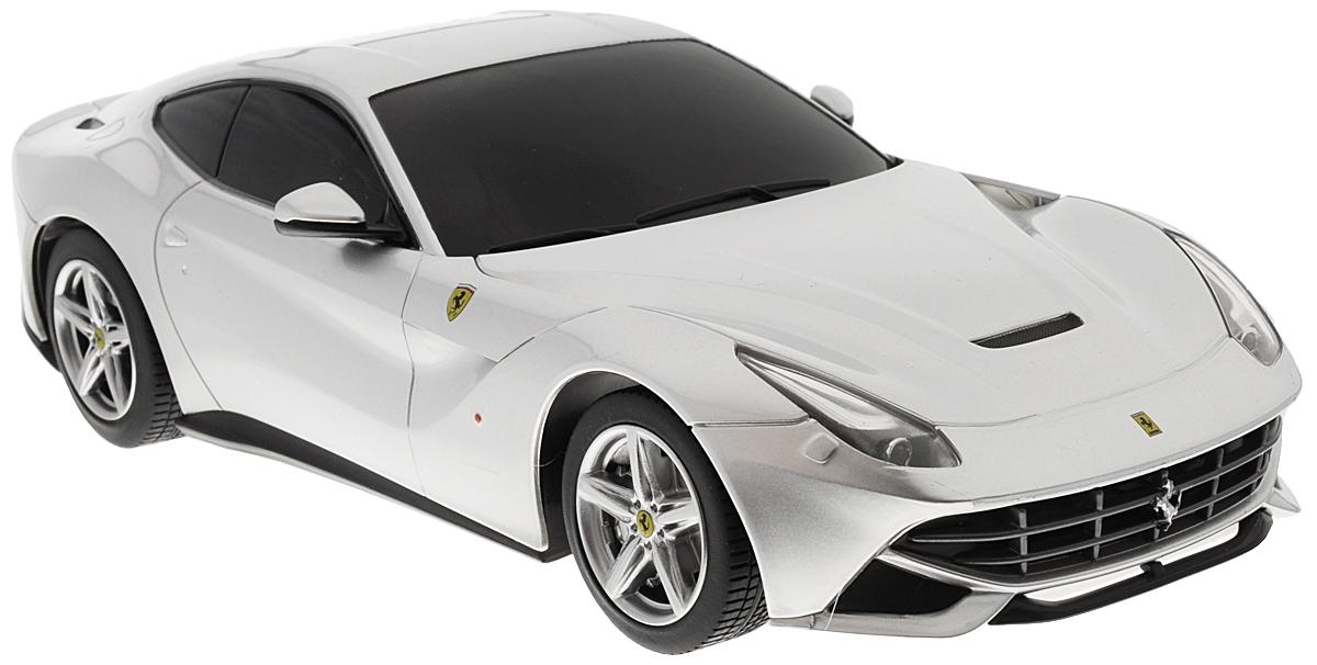 Rastar Радиоуправляемая модель с рулем Ferrari F12 Berlinetta цвет серебристый масштаб 1:1853500-10_серебристыйРадиоуправляемая модель Rastar Ferrari F12 Berlinetta станет отличным подарком любому мальчику! Все дети хотят иметь в наборе своих игрушек ослепительные, невероятные и модные автомобили на радиоуправлении. Тем более, если это автомобиль известной марки с проработкой всех деталей, удивляющий приятным качеством и видом. Одной из таких моделей является автомобиль на радиоуправлении Rastar Ferrari F12 Berlinetta. Это точная копия настоящего авто в масштабе 1:18. Возможные движения: вперед, назад, вправо, влево, остановка. При движении загораются фары и стоп-сигналы. Пульт управления выполнен в виде полнофункционального руля с переключателем передач, кнопками акселератора, тормоза, клаксона. При повороте руля возникает звуковой эффект ритмичного тиканья, и машина поворачивает. При нажатии на клаксон раздается звуковой сигнал. Пульт управления работает на частоте 40 MHz. Для работы машины необходимы 4 батарейки типа АА (не входят в комплект). ...