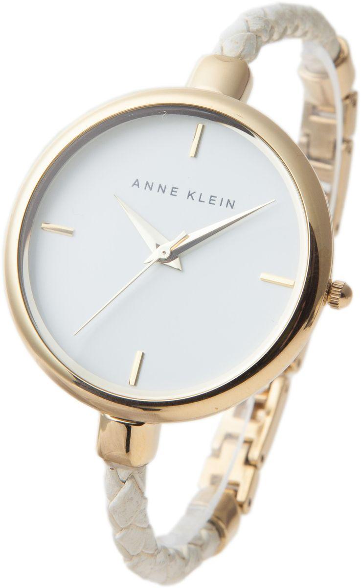 Часы наручные женские Anne Klein, цвет: белый, золотой. 1198WTWT1198WTWTОригинальные женские часы Anne Klein выполнены из металлического сплава, натуральной кожи и минерального стекла. Корпус и циферблат изделия дополнены символикой бренда. Корпус часов оснащен кварцевым механизмом, имеет степень влагозащиты равную 3 atm, а также дополнен устойчивым к царапинам минеральным стеклом. Ремешок часов выполнен в виде плетеного шнура из натуральной кожи и оснащен складным замком, который позволит с легкостью снимать и надевать изделие, а также регулировать длину ремешка. Часы поставляются в фирменной упаковке. Часы Anne Klein подчеркнут изящность женской руки и отменное чувство стиля у их обладательницы.