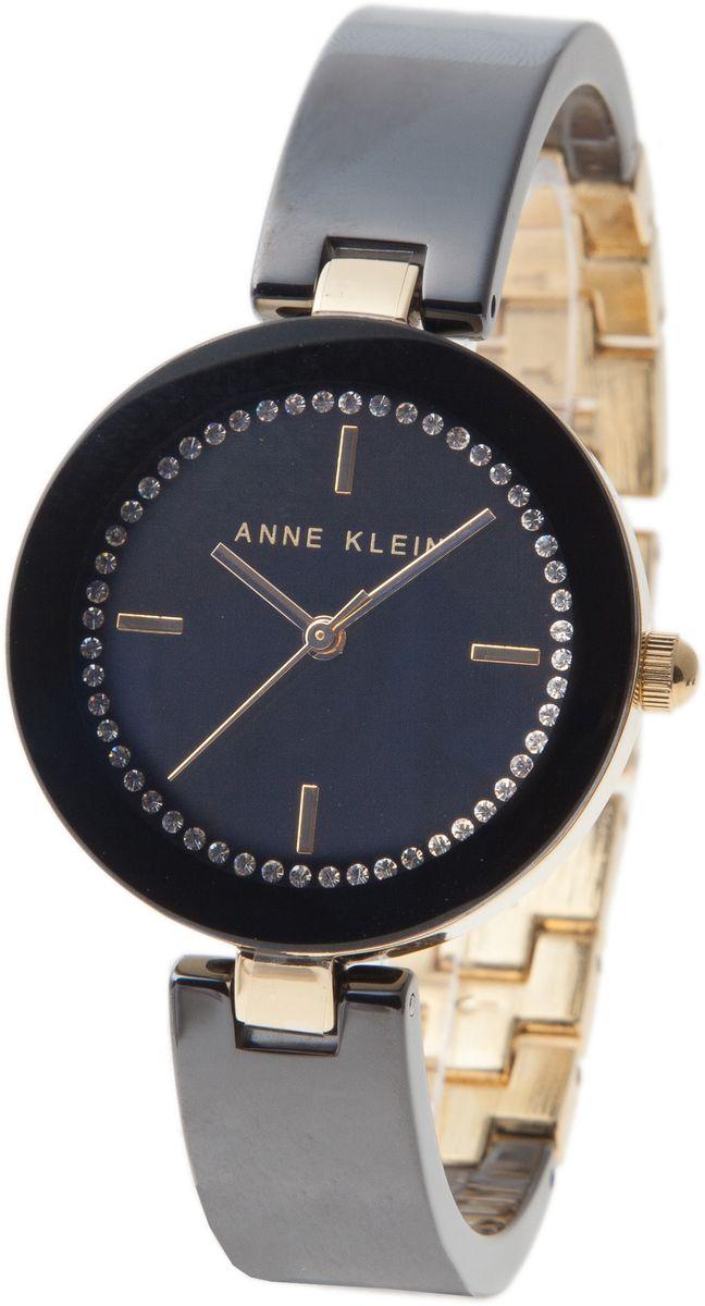 Часы наручные женские Anne Klein, цвет: черный, золотой. 1314BKBK1314BKBKЭлегантные женские часы Anne Klein выполнены из металлического сплава, керамики и минерального стекла. Циферблат изделия дополнен символикой бренда и стразами Svarowski. Корпус часов оснащен кварцевым механизмом, имеет степень влагозащиты равную 3 atm, а также дополнен устойчивым к царапинам минеральным стеклом. Браслет оснащен складным замком, который позволит с легкостью снимать и надевать изделие, а также регулировать длину. Часы поставляются в фирменной упаковке. Часы Anne Klein подчеркнут изящность женской руки и отменное чувство стиля у их обладательницы.