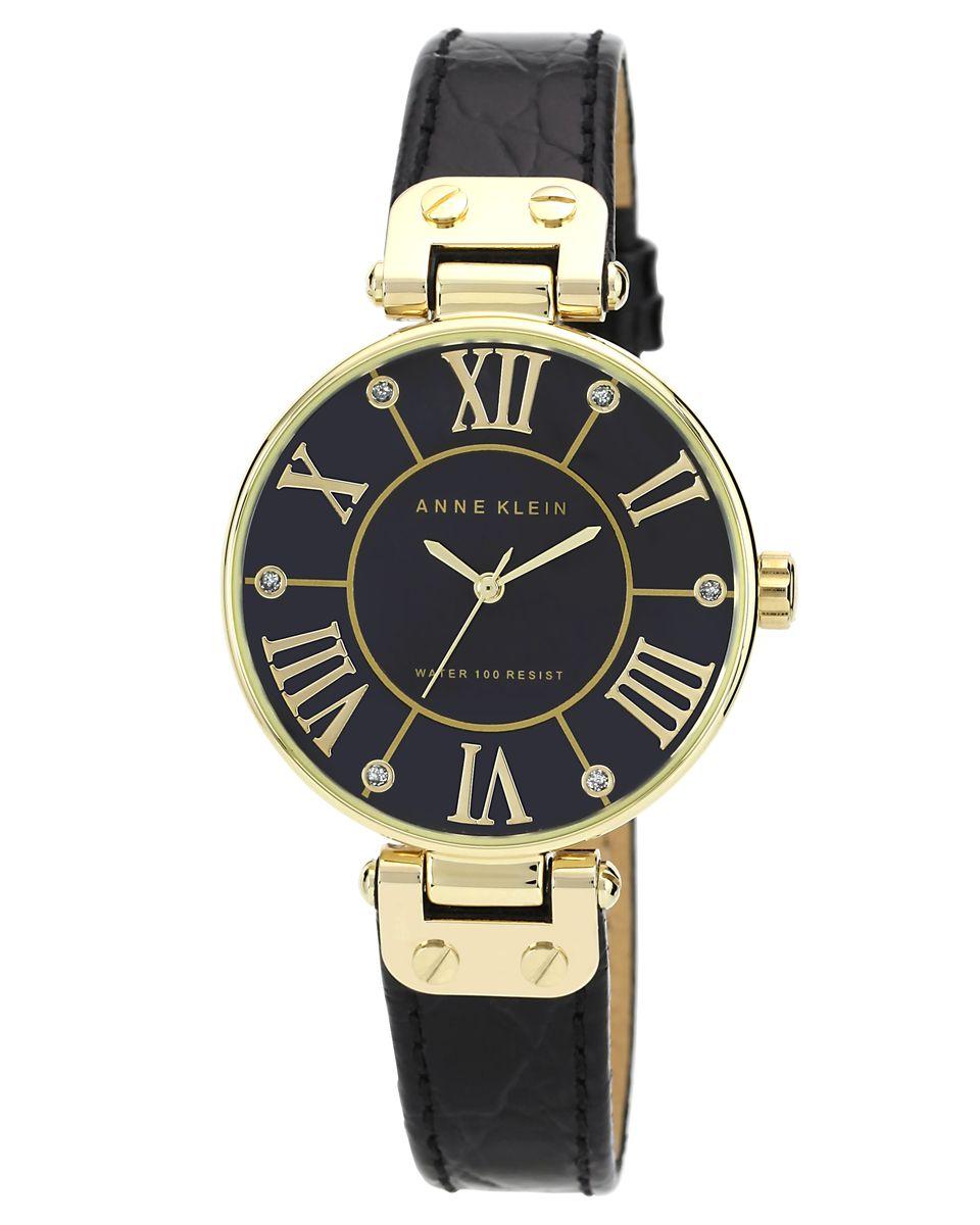 Часы наручные женские Anne Klein, цвет: черный, золотой. 1396BMBK1396BMBKОригинальные женские часы Anne Klein выполнены из металлического сплава, натуральной кожи и минерального стекла. Циферблат изделия дополнен символикой бренда и стразами. Корпус часов оснащен кварцевым механизмом, имеет степень влагозащиты равную 3 atm, а также дополнен устойчивым к царапинам минеральным стеклом. Ремешок часов выполнен из натуральной кожи с тиснением под рептилию, оснащен классической пряжкой, которая позволит с легкостью снимать и надевать изделие. Часы поставляются в фирменной упаковке. Часы Anne Klein подчеркнут изящность женской руки и отменное чувство стиля у их обладательницы.
