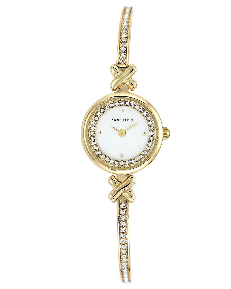 Часы наручные женские Anne Klein, цвет: белый, золотой. 1688MPGB1688MPGBЭлегантные женские часы Anne Klein выполнены из металлического сплава и минерального стекла. Циферблат изделия дополнен вставкой из перламутра, символикой бренда и стразами. Браслет часов оформлен стразами. Корпус часов оснащен кварцевым механизмом, имеет степень влагозащиты равную 3 atm, а также дополнен устойчивым к царапинам минеральным стеклом. Браслет оснащен складным замком, который позволит с легкостью снимать и надевать часы, а также регулировать длину изделия. Часы поставляются в фирменной упаковке. Часы Anne Klein подчеркнут изящность женской руки и отменное чувство стиля у их обладательницы.