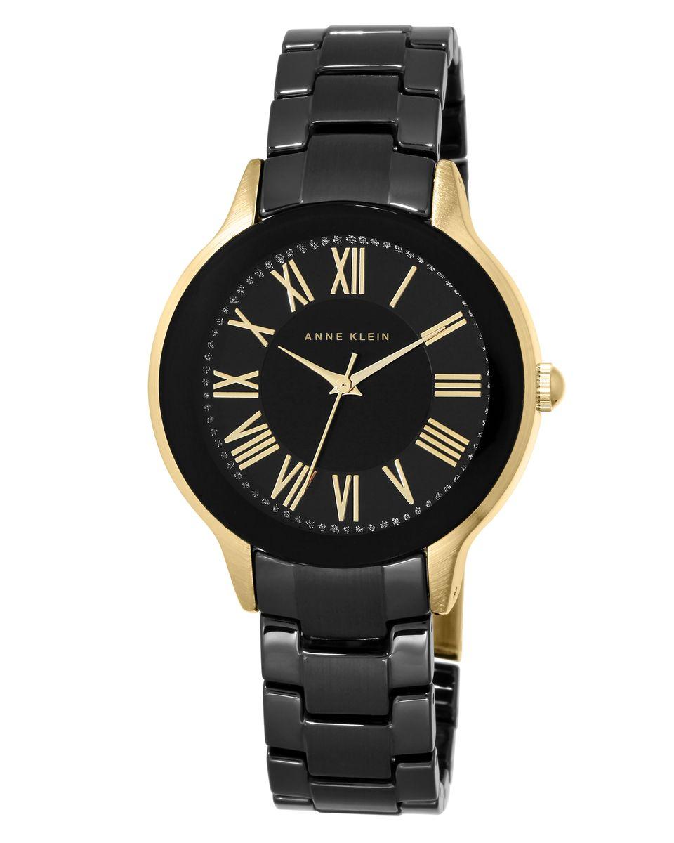 Часы наручные женские Anne Klein, цвет: черный, золотой. 1948BKGB1948BKGBЭлегантные женские часы Anne Klein выполнены из металлического сплава, керамики и минерального стекла. Циферблат изделия дополнен блестками и символикой бренда. Корпус часов оснащен кварцевым механизмом, имеет степень влагозащиты равную 3 atm, а также дополнен устойчивым к царапинам минеральным стеклом. Браслет оснащен складным замком, который позволит с легкостью снимать и надевать часы, а также регулировать длину изделия. Часы поставляются в фирменной упаковке. Часы Anne Klein подчеркнут изящность женской руки и отменное чувство стиля у их обладательницы.