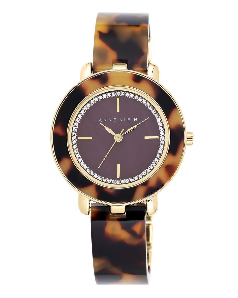 Часы наручные женские Anne Klein, цвет: коричневый, желтый. 1972BMTO1972BMTOЭлегантные женские часы Anne Klein выполнены из металлического сплава, пластика и минерального стекла. Циферблат изделия дополнен стразами и символикой бренда. Изделие оформлено животным принтом. Корпус часов оснащен кварцевым механизмом, имеет степень влагозащиты равную 3 atm, а также дополнен устойчивым к царапинам минеральным стеклом. Браслет оснащен складным замком, который позволит с легкостью снимать и надевать изделие, а также регулировать длину. Часы поставляются в фирменной упаковке. Часы Anne Klein подчеркнут изящность женской руки и отменное чувство стиля у их обладательницы.