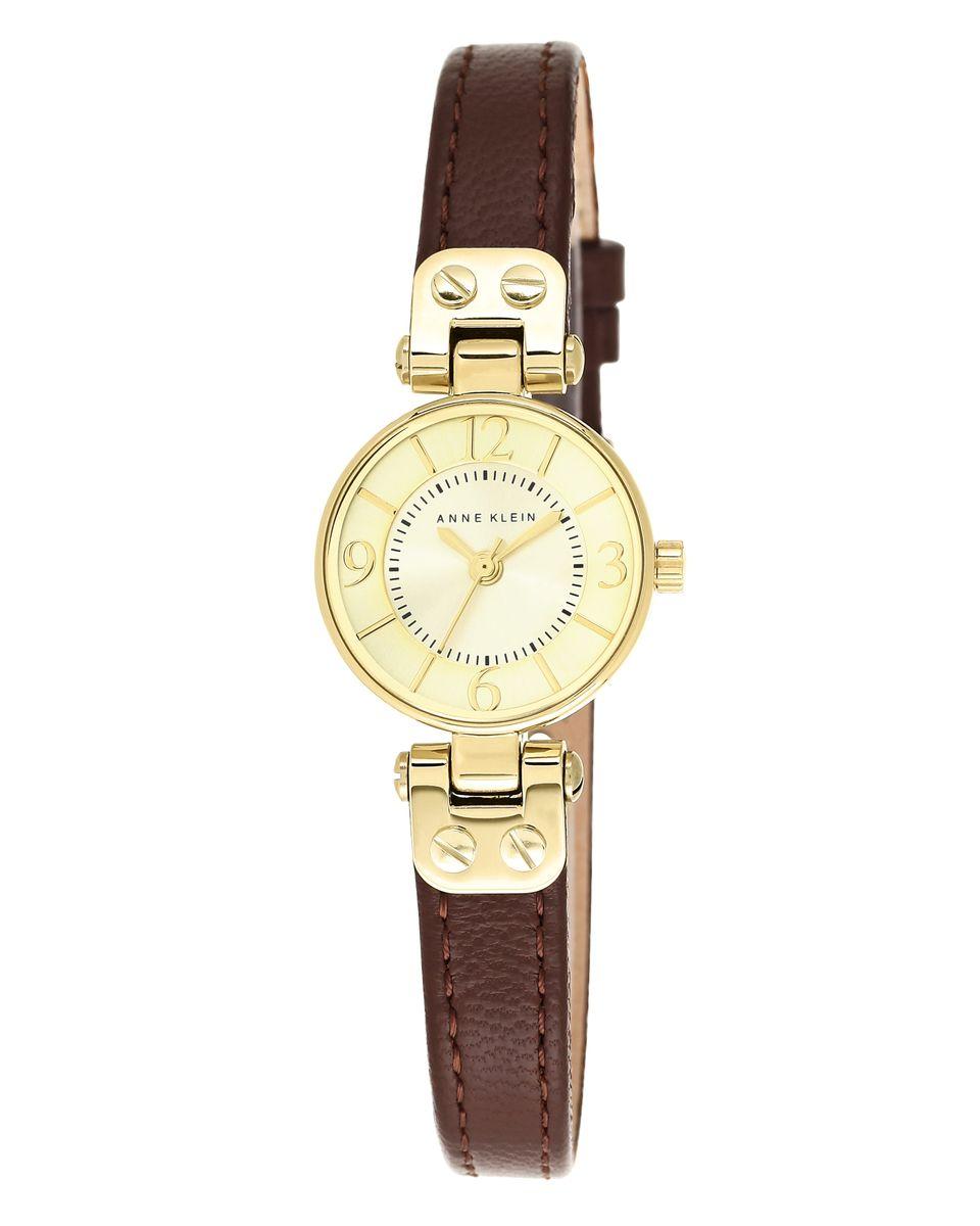 Часы наручные женские Anne Klein, цвет: коричневый, золотой. 2030CHBN2030CHBNЭлегантные женские часы Anne Klein выполнены из металлического сплава, натуральной кожи и минерального стекла. Циферблат изделия дополнен символикой бренда. Корпус часов оснащен кварцевым механизмом, имеет степень влагозащиты равную 3 atm, а также дополнен устойчивым к царапинам минеральным стеклом. Ремешок оснащен классическим замком-пряжкой, который позволит с легкостью снимать и надевать часы, а также регулировать длину изделия. Часы поставляются в фирменной упаковке. Часы Anne Klein подчеркнут изящность женской руки и отменное чувство стиля у их обладательницы.
