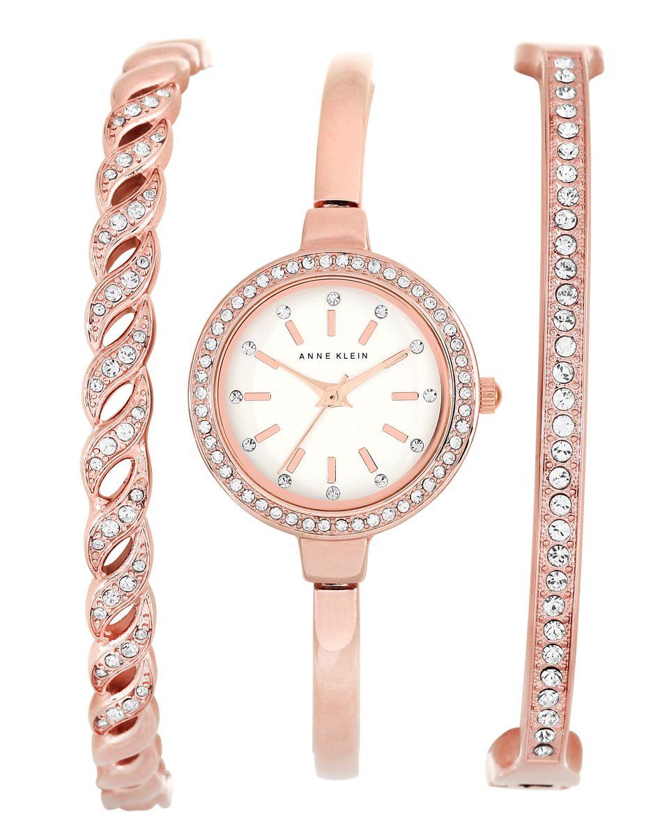 Наручные часы женские Anne Klein, цвет: белый, розовый. 2046RGST2046RGSTКорпус- металл, PVD покрытие розового цвета, циферблат серебристого цвета, кристаллы Svarowski, 24 мм, 2 дополнительных браслета, стекло: минеральное, кварцевый механизм, водозащита: 3 АТМ
