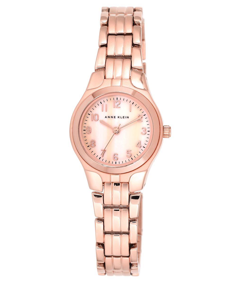 Часы наручные женские Anne Klein, цвет: золотой. 5490RMRG5490RMRGЭлегантные женские часы Anne Klein выполнены из металлического сплава и минерального стекла. Циферблат изделия дополнен символикой бренда и вставкой из перламутра. Корпус часов оснащен кварцевым механизмом, имеет степень влагозащиты равную 3 atm, а также дополнен устойчивым к царапинам минеральным стеклом. Браслет часов оснащен складным замком, который позволит с легкостью снимать и надевать изделие, а также регулировать длину. Часы поставляются в фирменной упаковке. Часы Anne Klein подчеркнут изящность женской руки и отменное чувство стиля у их обладательницы.