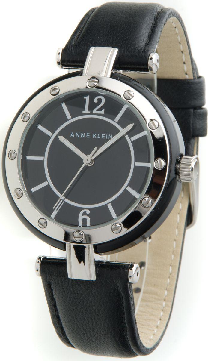 Часы наручные женские Anne Klein, цвет: серебряный, черный. 9995BKBK9995BKBKЭлегантные женские часы Anne Klein выполнены из металлического сплава, натуральной кожи и минерального стекла. Циферблат изделия дополнен символикой бренда. Корпус часов оснащен кварцевым механизмом, имеет степень влагозащиты равную 3 atm, а также дополнен устойчивым к царапинам минеральным стеклом. Ремешок часов оснащен классическим замком-пряжкой, который позволит с легкостью снимать и надевать часы, а также регулировать длину изделия. Часы поставляются в фирменной упаковке. Часы Anne Klein подчеркнут изящность женской руки и отменное чувство стиля у их обладательницы.