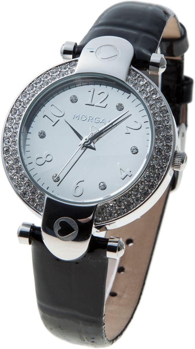 Часы наручные женские Morgan, цвет: стальной, черный. M1156SM1156SОригинальные женские часы Morgan выполнены из нержавеющей стали, натуральной кожи и минерального стекла. Корпус и циферблат изделия оформлены кристаллами Swarovski, циферблат часов дополнен зеркальной вставкой. Корпус часов оснащен кварцевым механизмом, имеет степень влагозащиты равную 3 atm, а также дополнен устойчивым к царапинам минеральным стеклом. Ремешок часов оснащен классической пряжкой, которая позволит с легкостью снимать и надевать изделие. Часы поставляются в фирменной упаковке. Часы Morgan подчеркнут изящность женской руки и отменное чувство стиля у их обладательницы.