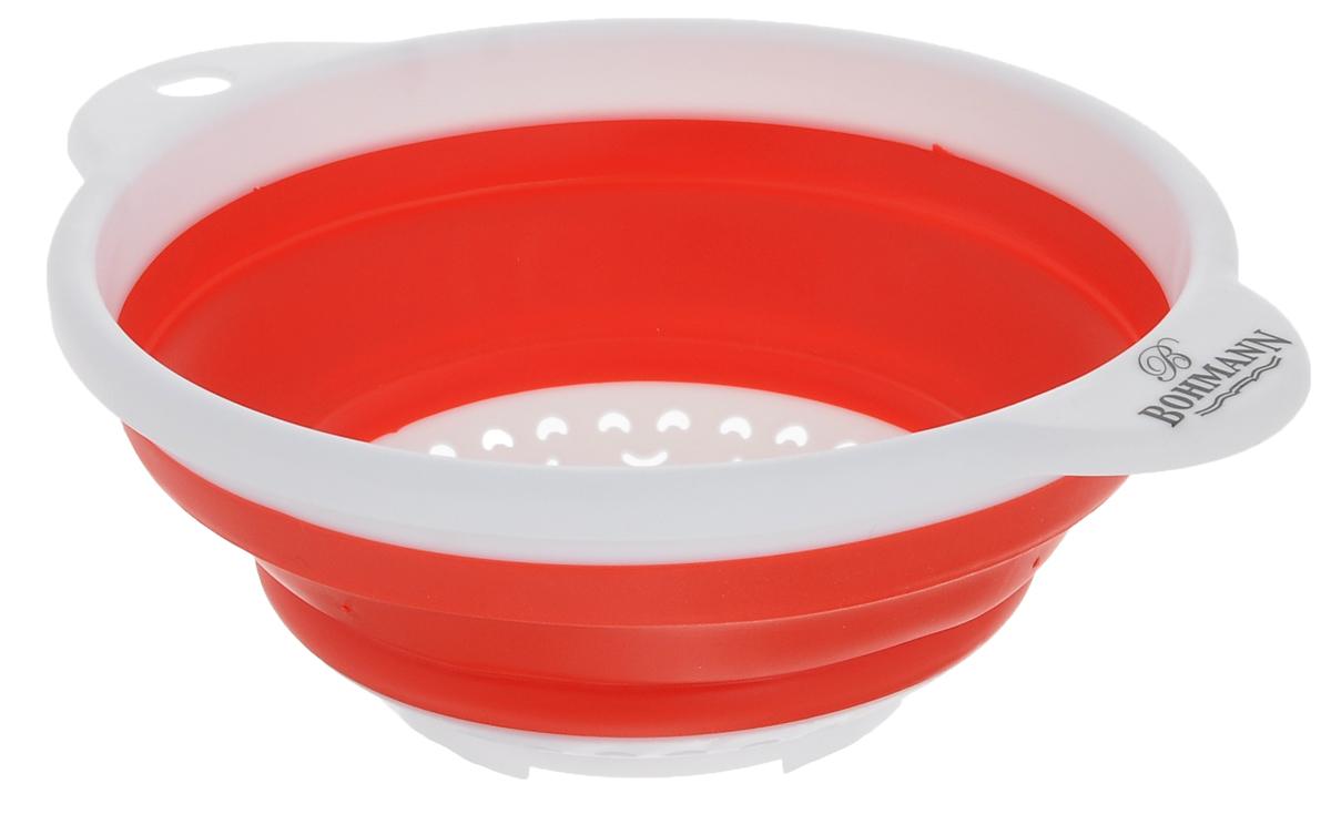 Дуршлаг Bohmann, цвет: белый, красный, диаметр 18 см7906BHNEW_белый, красныйСкладной дуршлаг Bohmann станет полезным приобретением для вашей кухни. Он изготовлен из высококачественного пищевого силикона и пластика. Оснащен 2 ручками. Прекрасно подходит для процеживания, ополаскивания и стекания макарон, овощей, фруктов. Дуршлаг компактно складывается, что делает его удобным для хранения. Внутренний диаметр: 18 см. Размер дуршлага (с учетом ручек): 23,5 см х 19,5 см. Минимальная высота дуршлага: 3,5 см. Максимальная высота дуршлага: 8,5 см.
