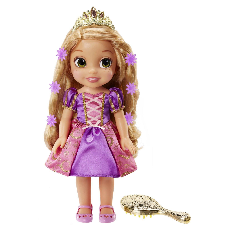 Disney Princess Кукла Рапунцель со светящимися волосами759440Очаровательная кукла Disney Princess Рапунцель со светящимися волосами порадует любую девочку и обязательно станет ее любимой игрушкой. Игрушка выполнена из пластика и изображает маленькую принцессу Рапунцель из одноименного мультфильма. Кукла одета в свое узнаваемое сиреневое платье, украшенное блестками. Длинные русые волосы куклы украшены заколками в виде цветочков и блестящей диадемой. Волосы красавицы светятся, как в сказке. Проведите расческой по волосам или нажмите на кнопку, расположенную на груди куклы - ее волосы засветятся, а Рапунцель споет куплет песни из мультфильма. Голова, руки и ноги куклы подвижны, что позволяет придавать ей различные позы. Игры с куклой способствуют эмоциональному развитию ребенка, а также помогают формировать воображение и художественный вкус. Малышка проведет множество счастливых часов, играя с очаровательной принцессой Рапунцель. Великолепное качество исполнения делают эту игрушку чудесным подарком к любому празднику. Для...
