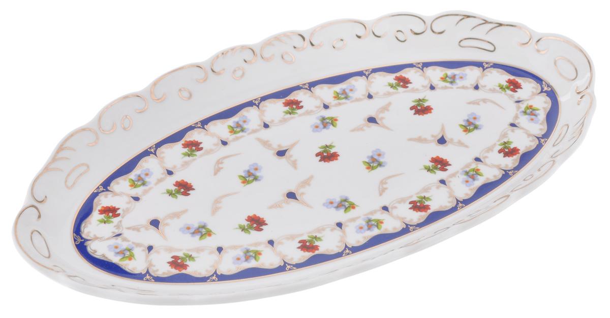 Селедочница Elan Gallery Цветочек, цвет: белый, синий, красный, 26 х 14 х 2,5 см503829Селедочница Elan Gallery Цветочек, изготовленная из высококачественной керамики, оформлена ярким изображением цветочных узоров. Изделие имеет специальную форму, которая идеально подходит для сервировки рыбы, а также нарезок и закусок. Селедочница Elan Gallery Цветочек великолепно украсит праздничный стол и станет прекрасным дополнением к вашему кухонному инвентарю.