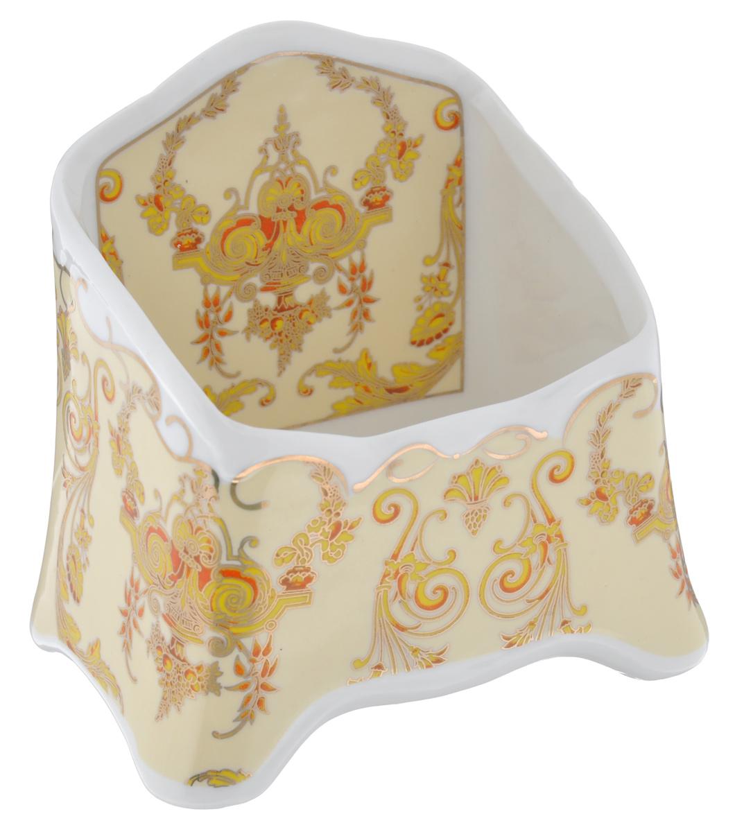 Подставка сервировочная для чайных пакетиков Elan Gallery Узоры, цвет: белый, желтый, золотистый, 10,5 х 7 х 10,5 см503967Сервировочная подставка для чайных пакетиков Elan Gallery Узоры, изготовленная из высококачественной керамики, порадует вас оригинальностью и дизайном. Изделие декорировано цветочными узорами и имеет изысканный внешний вид. Такая подставка, несомненно, понравится любой хозяйке и украсит интерьер любой кухни!