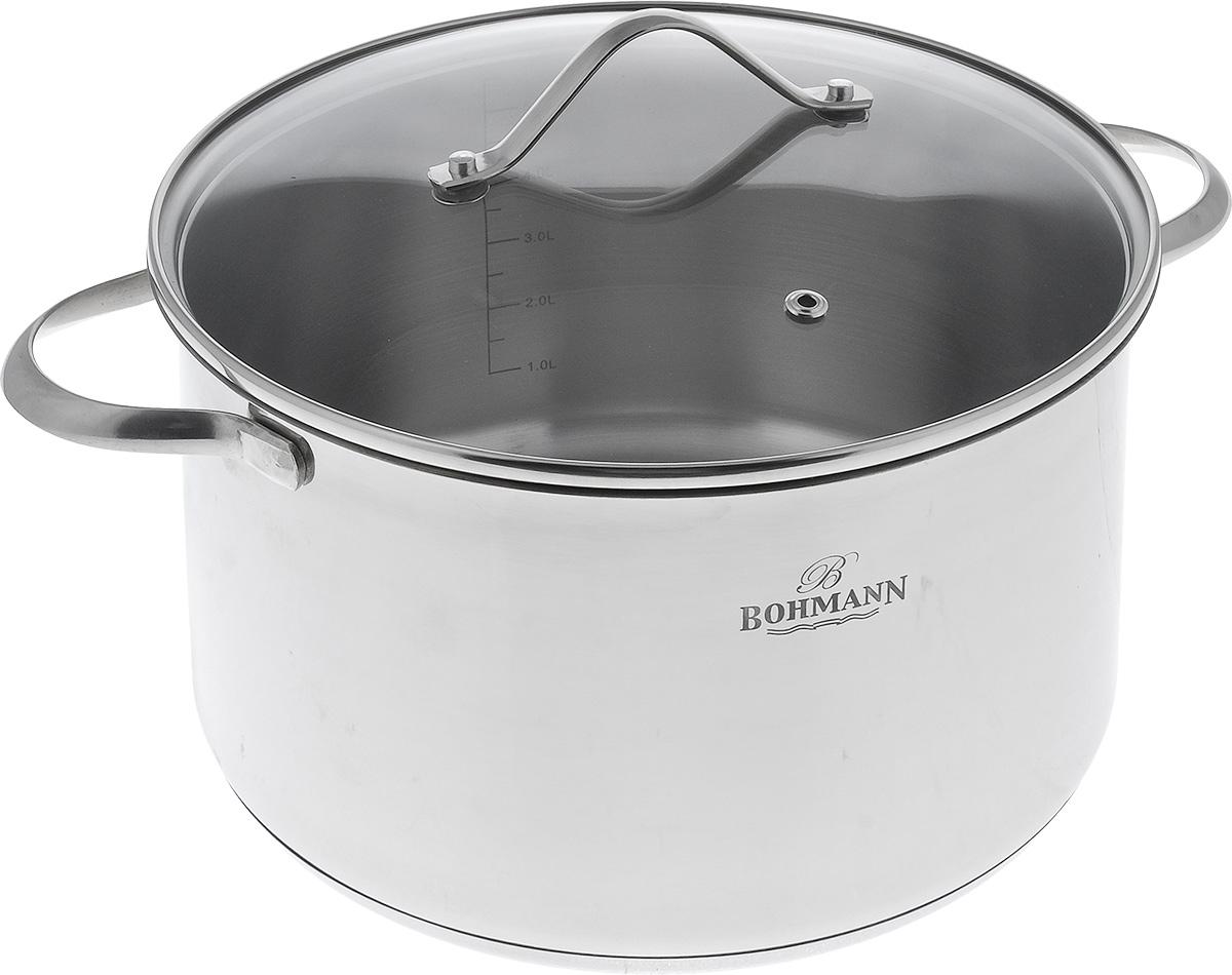 Кастрюля Bohmann с крышкой, 6,3 л232724BH/NEWКастрюля Bohmann изготовлена из нержавеющей хромоникелевой стали с внешней зеркальной полировкой. Знаменитая высококачественная сталь известна и популярна благодаря своей стойкости к коррозии и кислотам. Капсульное дно позволяет готовить блюда с минимальным количеством воды и жира, сохраняя при этом вкусовые и питательные свойства продуктов. Внутренние стенки имеют отметки литража. Кастрюля оснащена надежными ручками из нержавеющей стали. Крышка, изготовленная из термостойкого стекла, имеет отверстие для выхода пара. Можно мыть в посудомоечной машине. Подходит для всех типов плит, включая индукционные. Диаметр кастрюли: 24 см. Высота стенок: 14 см. Толщина стенок: 0,1 см. Толщина дна: 0,7 см. Ширина с учетом ручек: 33 см.