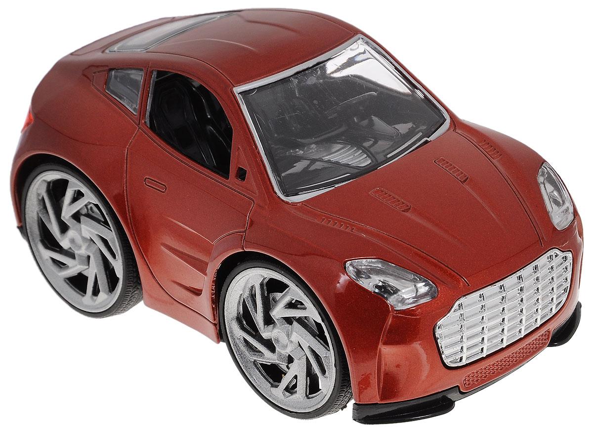 Tongde Машинка Молния цвет кирпичныйВ72300_коричневыйМашинка Tongde Молния, выполненная из металла и пластика, станет любимой игрушкой вашего малыша. Игрушка представляет собой легковой автомобиль, оснащенный звуковыми и световыми эффектами. Игрушка имеет функцию Встряхни и отпусти. Каждое встряхивание позволяет проехать 1 метр. Всего возможно 15 встряхиваний. Прорезиненные колеса обеспечивают надежное сцепление с любой гладкой поверхностью. Ваш ребенок будет часами играть с этой машинкой, придумывая различные истории. Порадуйте его таким замечательным подарком! Рекомендуется докупить 3 батарейки напряжением 1,5V типа ААА (товар комплектуется демонстрационными).