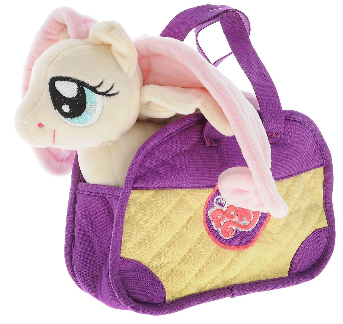 My Little Pony Мягкая игрушка Пони Флаттершай цвет сумки сиреневый 20 смMLPE4CМягкая игрушка My Little Pony Пони Флаттершай подарит вашему ребенку много радости и веселья. Она выполнена в виде персонажа мультфильма My Little Pony - пони Флаттершай. Игрушка удивительно приятна на ощупь. Она изготовлена из мягкого текстильного материала, глазки вышиты нитками. Чудесная мягкая игрушка принесет радость и подарит своему обладателю мгновения нежных объятий и приятных воспоминаний. Флаттершай очень любит зверей и всячески им помогает. Флаттершай очень добрая и стеснительная. Чудесная малышка станет любимой игрушкой вашего ребенка! В комплекте также находится симпатичная сумочка, в которую можно посадить милую лошадку или положить полезные мелочи.