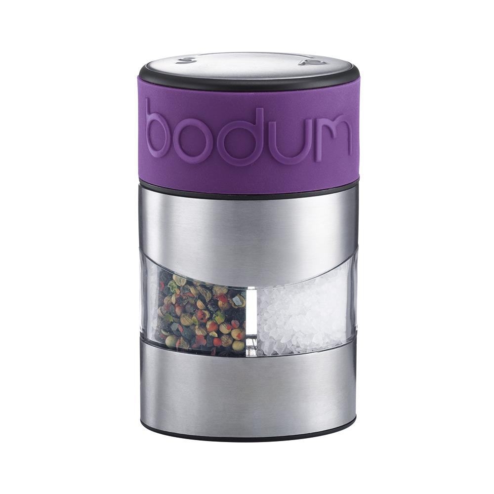 Мельница для перца и соли Bodum Twin, цвет: фиолетовыйA11002-914-Y15Мельница для перца и соли Bodum Twin, выполненная из прозрачного стекла и нержавеющей стали, позволяет солить и перчить одновременно. В верхней части мельницы имеется цветная силиконовая вставка. Мельница легка в использовании: одним поворотом силиконовой части мельницы приспособление переключается с солонки на перечницу, и вы сможете поперчить или добавить соль по своему вкусу в любое блюдо. Прочный керамический механизм позволяет молоть практически без усилий. Благодаря прозрачной конструкции легко определить, когда соль или перец заканчиваются. Оригинальная мельница модного дизайна будет отлично смотреться на вашей кухне и станет незаменимым предметом при приготовлении пищи. Мельниц уже содержит внутри соль и перец. Размер мельницы: 6,5 см х 6,5 см х 11 см.