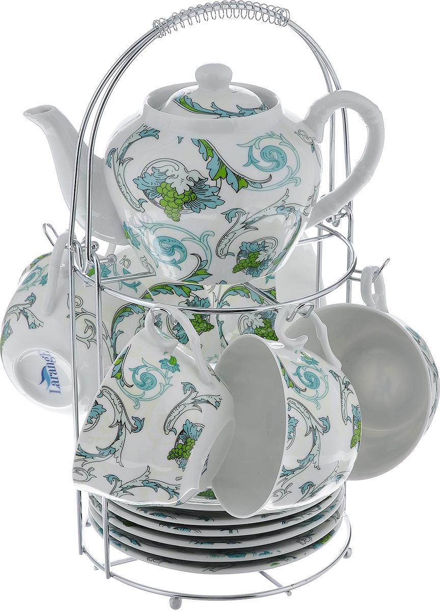 Чайный набор LarangE Рококо, цвет: белый, светло-зеленый, 14 предметов586-339Чайный набор LarangE Рококо состоит из шести чашек, шести блюдец и заварочного чайника, изготовленных из фарфора. Предметы набора оформлены изящным ярким рисунком и размещаются на металлической подставке. Чайный набор LarangE Рококо украсит ваш кухонный стол, а также станет замечательным подарком друзьям и близким. Объем чашки: 250 мл. Диаметр чашки по верхнему краю: 9 см. Высота чашки: 6 см. Диаметр блюдца: 14,5 см. Объем чайника: 600 мл. Диаметр чайника по верхнему краю: 7 см. Высота чайника (без учета крышки): 9 см. Размеры подставки (без учета ручки): 16 см х 20 см х 20 см.