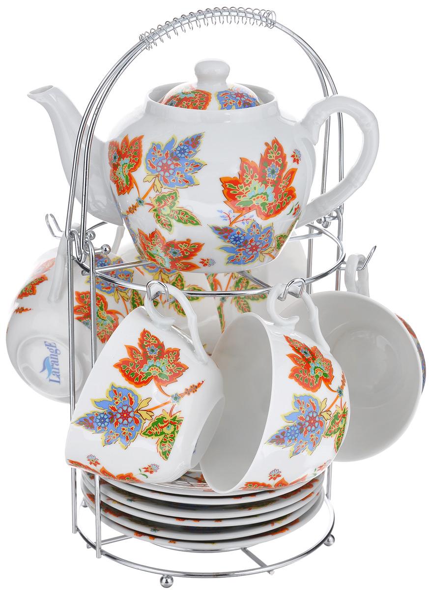 Набор чайный LarangE Восточный микс, 14 предметов586-342Чайный набор LarangE Восточный микс состоит из 6 чашек, 6 блюдец, чайника и подставки. Изделия выполнены из высококачественного фарфора и украшены ярким рисунком. Изящный чайный набор прекрасно оформит стол к чаепитию и станет замечательным подарком для любой хозяйки. Все изделия удобно располагаются на металлической подставке. Можно использовать в микроволновой печи. Объем чашки: 250 мл. Диаметр чашки (по верхнему краю): 9,5 см. Высота чашки: 6,2 см. Диаметр блюдца (по верхнему краю): 15 см. Высота блюдца: 2 см. Объем чайника: 600 мл. Высота чайника (без учета крышки): 9,5 см. Диаметр чайника (по верхнему краю): 7,2 см. Размер подставки: 17 см х 20 см 30 см.