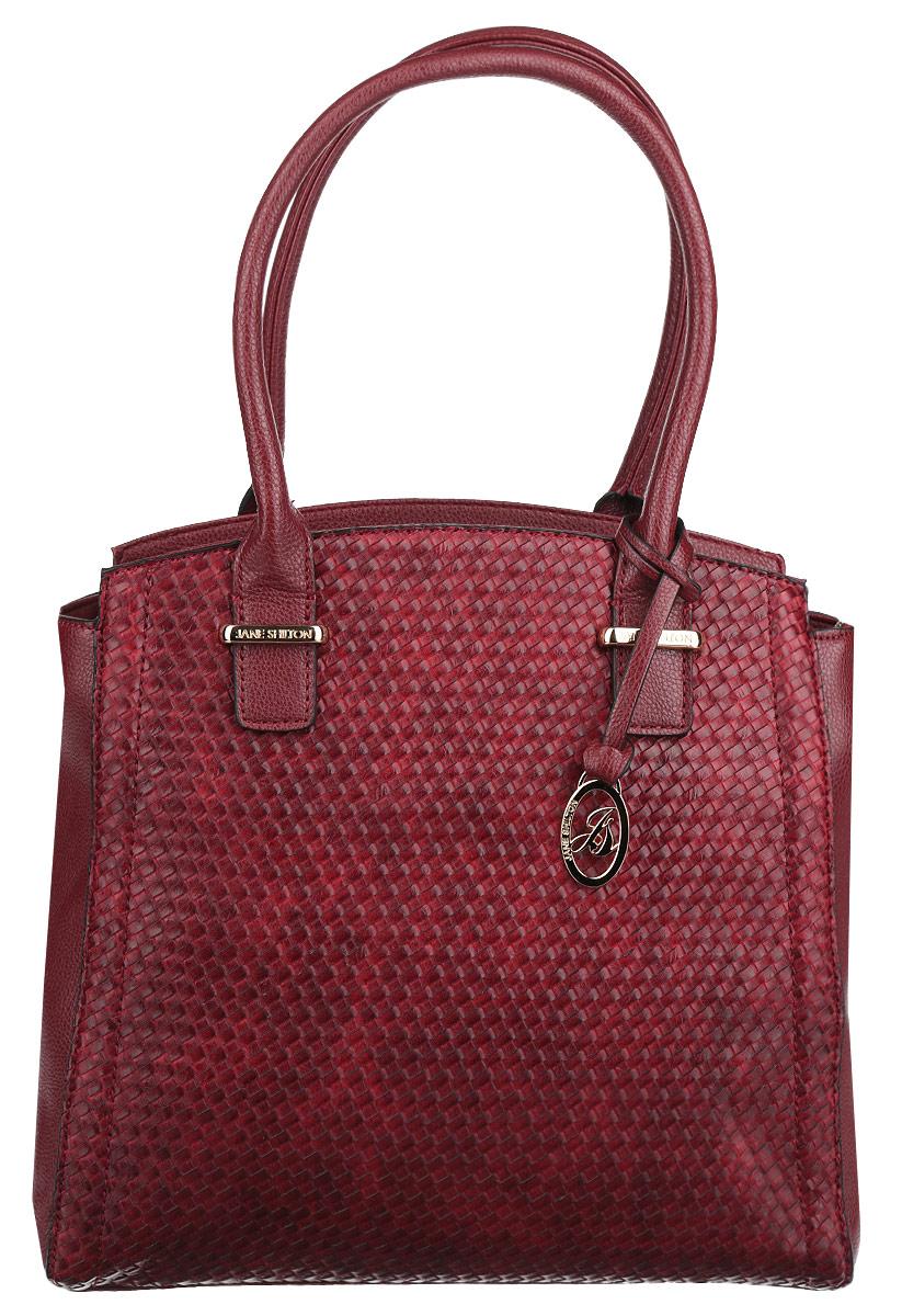 Сумка женская Jane Shilton, цвет: красный. 19131913redСтильная сумка Jane Shilton выполнена из искусственной кожи с декоративным тиснением, оформлена металлической фурнитурой и подвеской с символикой бренда. Изделие содержит одно отделение, которое закрывается на застежку-молнию. Внутри изделия расположены врезной карман на застежке-молнии, карман-средник на молнии и накладной карман для телефона. Снаружи, на задней стороне сумки, расположен врезной карман на молнии. Сумка оснащена двумя практичными ручками, которые позволят носить изделие, как в руках, так и на плече. Ручки дополнены металлической фурнитурой. Оригинальный аксессуар позволит вам завершить образ и быть неотразимой.