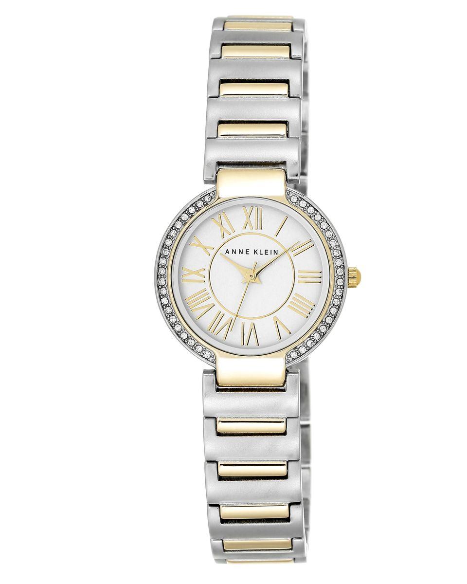 Часы наручные женские Anne Klein, цвет: серебряный, золотой. 2037 SVTT2037 SVTTЭлегантные женские часы Anne Klein выполнены из металлического сплава и минерального стекла. Циферблат изделия дополнен символикой бренда. Корпус оформлен стразами Svarowski. Корпус часов оснащен кварцевым механизмом, имеет степень влагозащиты равную 3 atm, а также дополнен устойчивым к царапинам минеральным стеклом. Браслет часов оснащен складным замком, который позволит с легкостью снимать и надевать изделие, а также регулировать длину. Часы поставляются в фирменной упаковке. Часы Anne Klein подчеркнут изящность женской руки и отменное чувство стиля у их обладательницы.