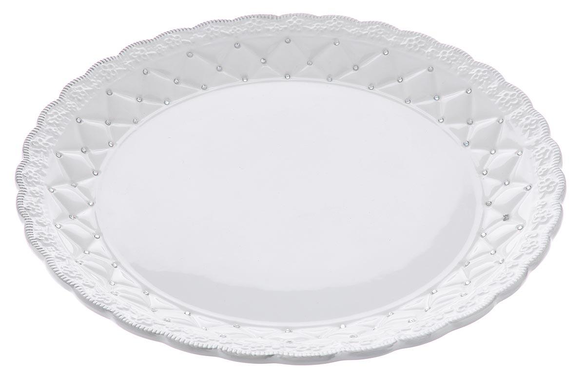 Блюдо Loraine Ажур, диаметр 30,5 см23845Блюдо Loraine Ажур, изготовленное из высококачественного доломита, украшено оригинальным ажурным узором и стразами. Стильная форма и интересное исполнение идеально впишутся в любой стиль, а универсальный белый цвет подойдет к любой мебели. Такое блюдо принесет новизну в вашу кухню и приятно порадует глаз. Диаметр (по верхнему краю): 30,5 см. Высота: 3,5 см.