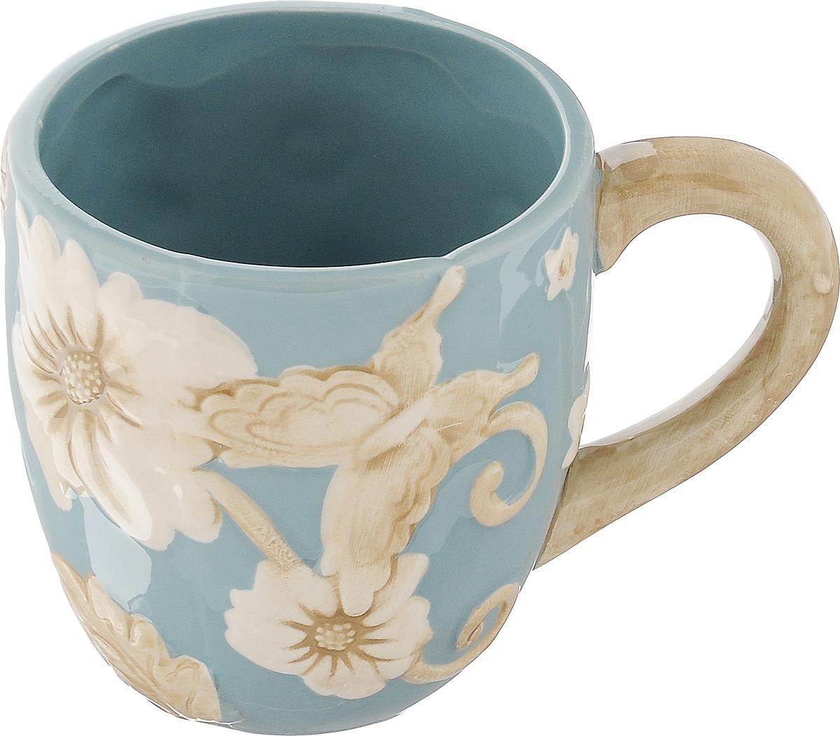 Кружка Mayer & Boch Розы, цвет: голубой, 310 мл22451Кружка Mayer & Boch Цветы изготовлена из высококачественного материала доломита и декорирована рельефным цветочным рисунком. Изделие оснащено удобной ручкой. Такая кружка станет практичным сувениром и незаменимым атрибутом чаепития, а оригинальное оформление добавит ярких эмоций в процессе чаепития. Можно мыть в посудомоечной машине и использовать в микроволновой печи. Диаметр кружки (по верхнему краю): 8 см. Высота кружки: 9 см. Объем кружки: 310 мл.