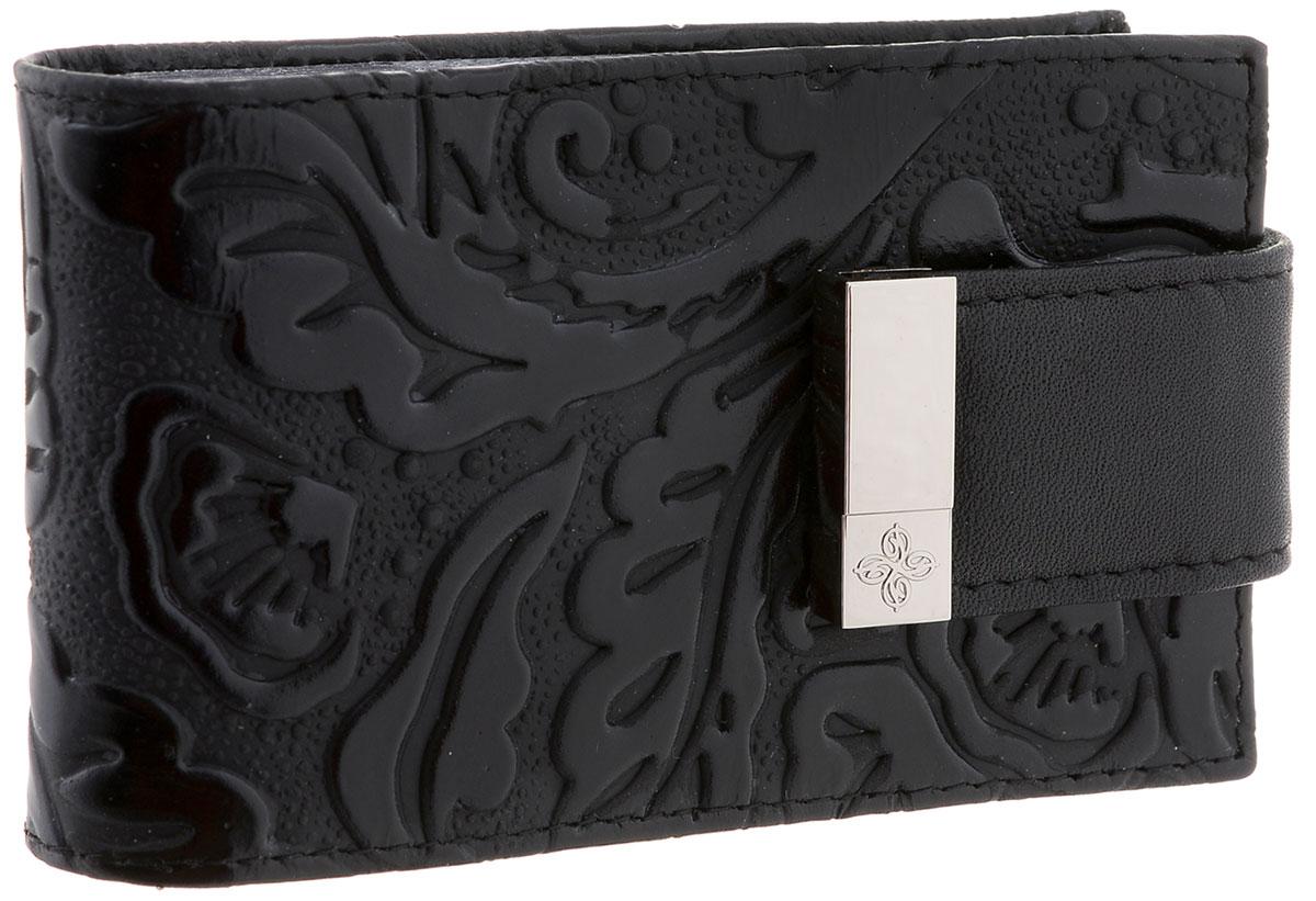Визитница женская Dimanche Арабеска, цвет: черный. 994/1994/1Женская визитница Dimanche Elite. Арабеска выполнена из высококачественной натуральной кожи и оформлена рельефным рисунком. Внутри имеется три боковых кармана и блок из прозрачного пластика с шестнадцатью файлами для визиток. Изделие закрывается на хлястик с кнопкой. Такая визитница станет отличным подарком для человека, ценящего качественные и практичные вещи.