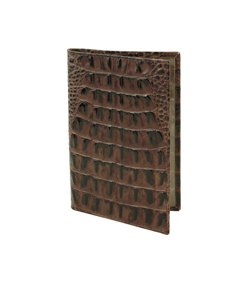 Обложка для паспорта женская Dimanche, цвет: коричневый. 450/9450/9Стильная обложка для паспорта Dimanche выполнена из натуральной кожи с тиснением под крокодила. На внутреннем развороте имеются два кармана из прозрачного пластика. Обложка не только поможет сохранить внешний вид ваших документов и защитить их от повреждений, но и станет стильным аксессуаром, идеально подходящим вашему образу. Обложка для паспорта стильного дизайна может быть достойным и оригинальным подарком.