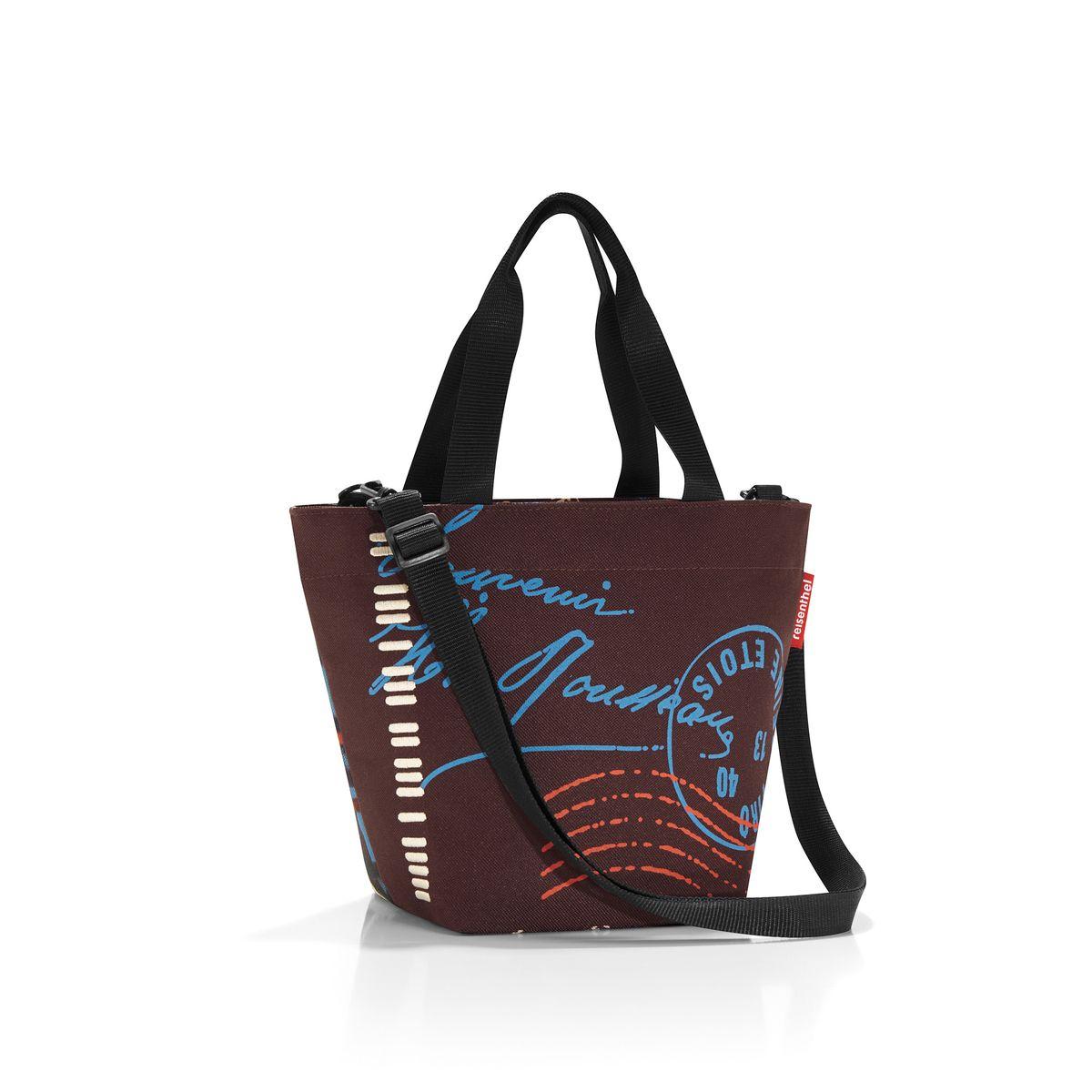 Сумка женская Reisenthel, цвет: коричневый, красный, голубой. ZR7037ZR7037Женская сумка Reisenthel изготовлена из полиэстера с оригинальным принтом. Сумка имеет одно отделение, которое закрывается на застежку-молнию. Внутри имеется нашивной карман на застежке-молнии. Изделие оснащено двумя текстильными ручками. В комплект входит съемный плечевой ремень. Такая сумка станет незаменимой в повседневной жизни.