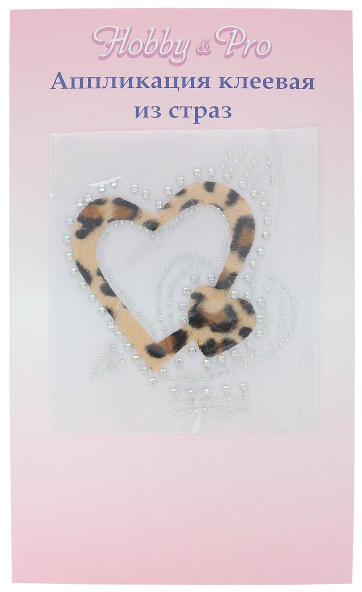 Термоаппликация Hobby & Pro Сердце со стрелой, цвет: леопард, 10 см х 11 см7713573_4 леопардТермоаппликация Hobby & Pro изготовлена из текстиля в виде сердца, декорирована сверкающими стразами и принтом под леопарда. Термоаппликация с обратной стороны оснащена клеевым слоем, благодаря которому при помощи утюга вы сможете быстро и легко закрепить изделие на ткани. С такой термоаппликацией любая вещь станет особенной.