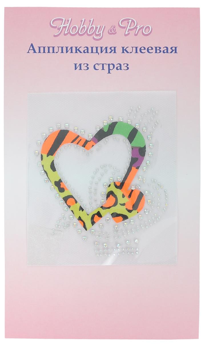 Термоаппликация Hobby&Pro Сердце со стрелой, цвет: оранжевый, желтый, зеленый, 10 х 11 см7713573_5 разноцветныйТермоаппликация Hobby & Pro изготовлена из текстиля в виде сердца, декорирована сверкающими стразами и ярким разноцветным принтом. Термоаппликация с обратной стороны оснащена клеевым слоем, благодаря которому при помощи утюга вы сможете быстро и легко закрепить изделие на ткани. С такой термоаппликацией любая вещь станет особенной.