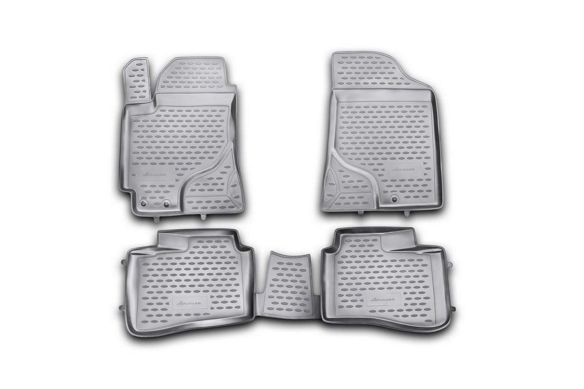 Набор автомобильных ковриков Novline-Autofamily для Kia Cerato 2009-2013, в салон, цвет: черный, 4 шт. NLC.25.26.210hNLC.25.26.210hНабор автомобильных ковриков Novline-Autofamily, изготовленный из полиуретана, состоит из 4 ковриков, которые учитывают все особенности каждой модели автомобиля и полностью повторяют контуры пола. Полиуретановые автомобильные коврики для салона произведены из высококачественного материала, который держит форму, прочный и не пачкает обувь. Коврики в салон не только улучшат внешний вид салона вашего автомобиля, но и надежно уберегут его от пыли, грязи и сырости, а значит, защитят кузов от коррозии. Полиуретановые коврики для автомобиля гладкие, приятные и не пропускают влагу. Ковры для автомобилей надежно крепятся на полу и не скользят, что очень важно во время движения. Чистятся коврики очень просто: как при помощи автомобильного пылесоса, так и различными моющими средствами. Набор подходит для Kia Cerato 2009-2013 годов выпуска.
