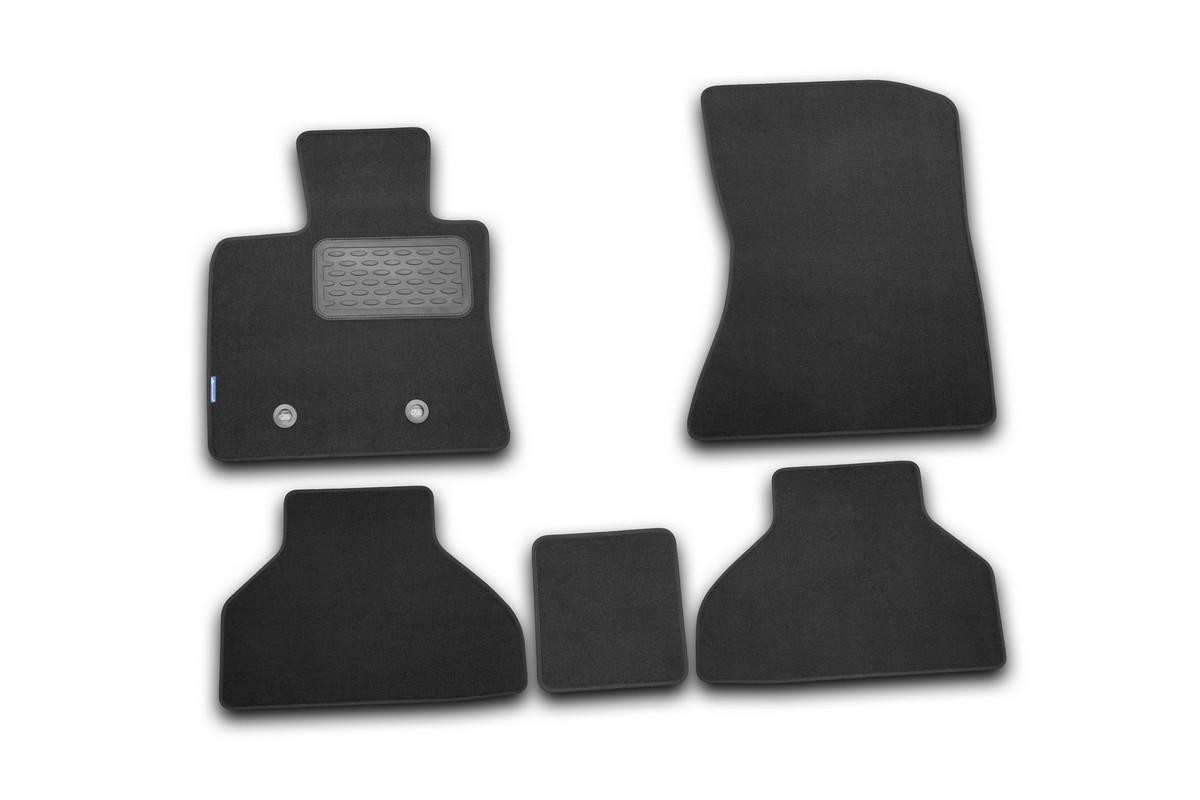 Набор автомобильных ковриков Novline-Autofamily для BMW X5 2007-, внедорожник, в салон, 5 штNLT.05.17.11.110khНабор автомобильных ковриков Novline-Autofamily, изготовленный из текстиля, состоит из 5 ковриков, которые учитывают все особенности каждой модели автомобиля и полностью повторяют контуры пола. Текстильные автомобильные коврики для салона произведены из высококачественного материала, который держит форму, прочный и не пачкает обувь. Коврики в салон не только улучшат внешний вид салона вашего автомобиля, но и надежно уберегут его от пыли, грязи и сырости, а значит, защитят кузов от коррозии. Текстильные коврики для автомобиля мягкие и приятные, а их основа из вспененного полиуретана не пропускает влагу. Ковры для автомобилей надежно крепятся на полу и не скользят, что очень важно во время движения. Чистятся коврики очень просто: как при помощи автомобильного пылесоса, так и различными моющими средствами. Набор подходит для BMW X5 внедорожник с 2007 года выпуска.