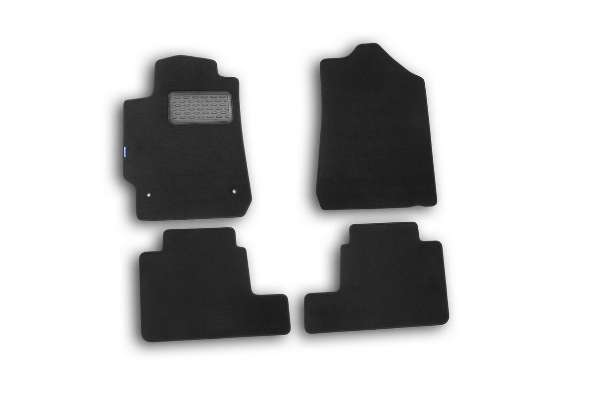 Набор автомобильных ковриков Novline-Autofamily для Toyota Camry 2006-2011, седан, в салон, цвет: черный, 4 штNLT.48.52.11.110khНабор автомобильных ковриков Novline-Autofamily, изготовленный из текстиля, состоит из 4 ковриков, которые учитывают все особенности каждой модели автомобиля и полностью повторяют контуры пола. Текстильные автомобильные коврики для салона произведены из высококачественного материала, который держит форму, прочный и не пачкает обувь. Коврики в салон не только улучшат внешний вид салона вашего автомобиля, но и надежно уберегут его от пыли, грязи и сырости, а значит, защитят кузов от коррозии. Текстильные коврики для автомобиля мягкие и приятные, а их основа из вспененного полиуретана не пропускает влагу. Ковры для автомобилей надежно крепятся на полу и не скользят, что очень важно во время движения. Чистятся коврики очень просто: как при помощи автомобильного пылесоса, так и различными моющими средствами. Набор подходит для Toyota Camry седан 2006-2011 годов выпуска.