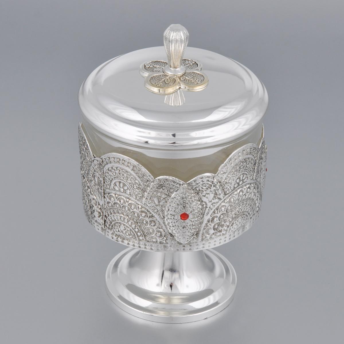 Сахарница Marquis. 2190-MR2190-MRСахарница Marquis изготовлена из стали с никель-серебряным покрытием. Изделие выполнено в классическом стиле и украшено изящным рельефом и перфорацией. Сахарница оснащена стеклянной емкостью и крышкой. Сахарница Marquis станет незаменимым атрибутом любого чаепития, праздничного, вечернего или на открытом воздухе, а также подчеркнет ваш изысканный вкус. Диаметр сахарницы (по верхнему краю): 8,5 см. Диаметр основания: 6,8 см. Высота сахарницы (без учета крышки): 10,5 см. Высота сахарницы (с учетом крышки): 14,5 см.