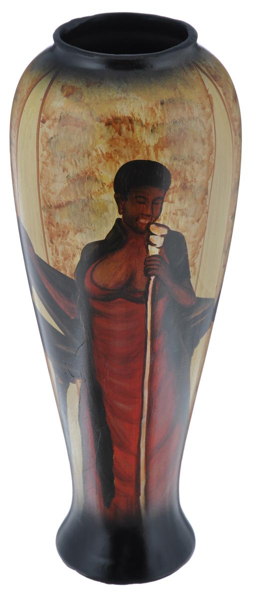 Ваза Sima-land Певица, высота 34,5 см106851Стильная ваза ручной работы Sima-land Певица изготовлена из прочной керамики. Изделие оформлено красочным изображением поющей женщины-негритянки и оснащено антискользящими вставками на дне. Такая изящная ваза с легкостью впишется практически в любой интерьер. Она станет изумительным подарком, который доставит радость, ведь это не только красивый, но еще и функциональный презент.