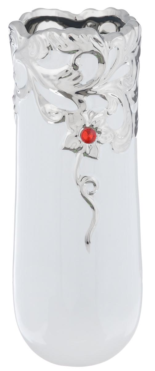 Ваза Sima-land Капля, высота 24,5 см865956Изящная ваза Sima-land Капля изготовлена из высококачественной керамики. Изделие оформлено объемными цветочными узорами и декорировано цветными камнями, выполненными из пластика. Дно вазы оснащено антискользящими накладками. Такая оригинальная ваза с легкостью впишется практически в любой интерьер. Она станет изумительным подарком, который доставит радость, ведь это не только красивый, но еще и функциональный презент. Любое помещение выглядит незавершенным без правильно расположенных предметов интерьера. Они помогают создать уют, расставить акценты, подчеркнуть достоинства или скрыть недостатки.