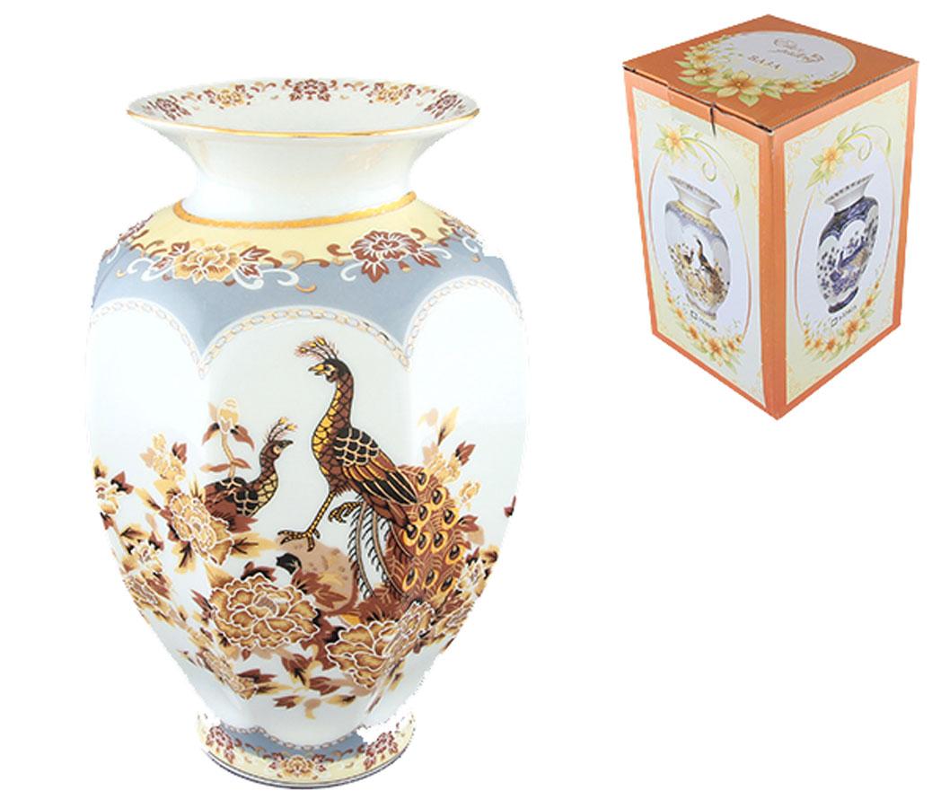 Ваза Elan Gallery Павлин, высота 19,5 см503936Стильная ваза Elan Gallery Павлин изготовлена из высококачественного фарфора. Интересная форма и необычное оформление сделают эту вазу замечательным украшением интерьера. Изделие вместит в себя достаточно пышный букет. Более того, в такой вазе превосходно будут смотреться декоративные веточки и сухоцветы. Любое помещение выглядит незавершенным без правильно расположенных предметов интерьера. Они помогают создать уют, расставить акценты, подчеркнуть достоинства или скрыть недостатки.