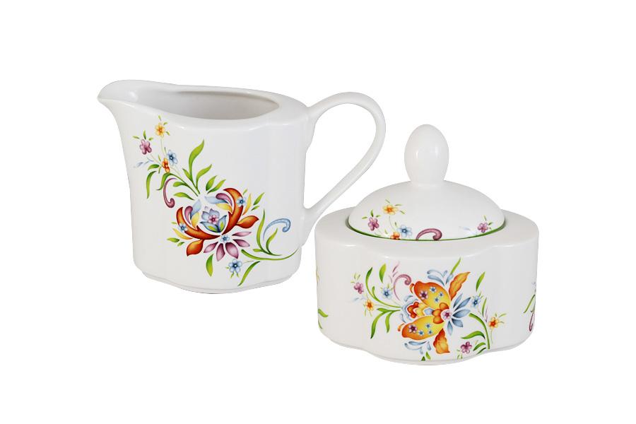 Набор Imari Аквитания: сахарница, молочникIMA0018BC-DA2099ALНабор Imari Аквитания, состоящий из сахарницы с крышкой и молочника, выполнен из высококачественной глазурованной керамики. Изделия, декорированные красочным изображением цветов, имеют изысканный внешний вид. Такой набор прекрасно подойдет для сервировки стола и станет незаменимым атрибутом чаепития. Объем молочника: 300мл. Объем сахарницы: 250 мл.