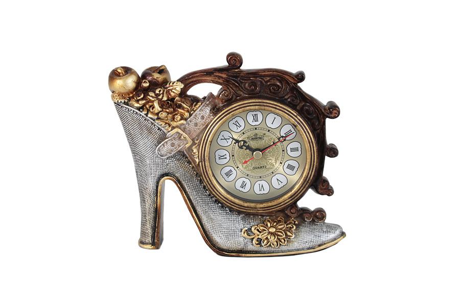 Часы настольные Туфелька. LI-LS-672AM-ALLI-LS-672AM-ALКомпания LISHENG – частное предприятие, в течение многих лет специализирующееся на производстве предметов интерьера из полирезина. Основные направления ассортимента: настенные, настольные и напольные часы, светильники, телефоны в стиле ретро, фонтаны, разнообразные украшения для дома. Передовые технологии и инновационные идеи позволяют мастерам компании в полной мере проявить свое искусство и изобретательность при создании предметов интерьера. Все модели имеют оригинальный фигурный корпус, выполненный из полирезина - экологичного и безвредного полимерного материала, высокие гигиенические качества которого заключаются в отсутствии запаха и легкости ухода за поверхностями изделия. Во всех часах установлен высококачественный кварцевый механизм. Некоторые модели дополнительно снабжены термометром.