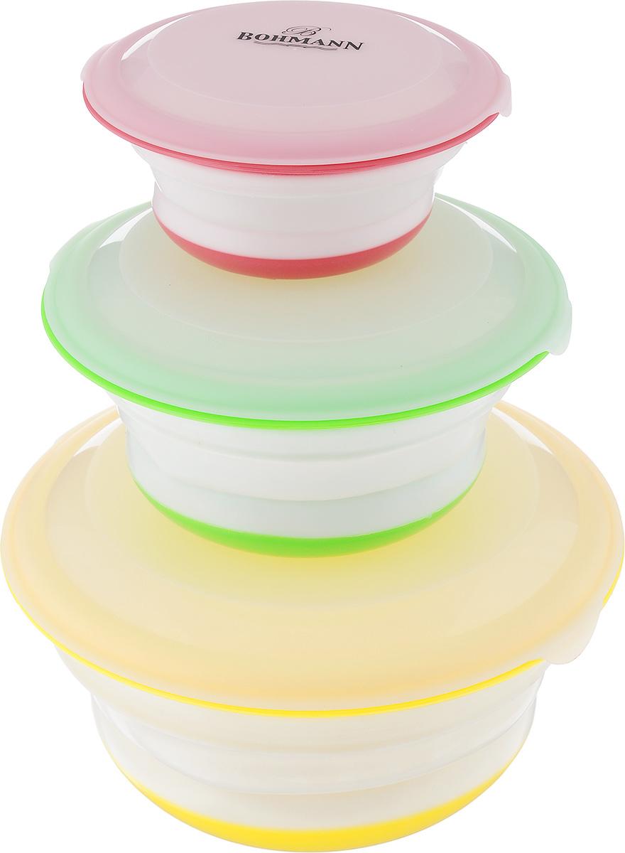 Набор мисок Bohmann с крышками, цвет: желтый, зеленый, красный, 6 предметов02543BHНабор Bohmann состоит из трех мисок разного цвета и размера, выполненных из силикона и высококачественного пластика. Миски снабжены плотно прилегающими крышками. Они легко чистятся. Изделия являются универсальным приобретением для любой кухни. С их помощью можно хранить продукты и даже сервировать стол. Оригинальный дизайн, высокое качество и функциональность набора позволят ему стать достойным дополнением к вашему кухонному инвентарю. Выдерживают температуру от-40°С до +230°С. Можно использовать в микроволновой печи и мыть в посудомоечной машине. Диаметр мисок: 19 см, 16 см, 13 см. Высота стенок мисок: 3,5 см, 3,5 см, 2,5 см. Объемы мисок: 1,4 л, 750 мл, 400 мл.