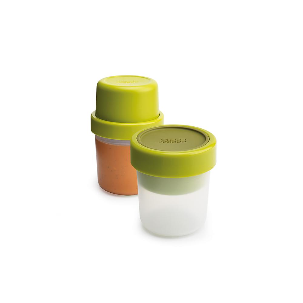 Ланч-бокс для супа компактный GoEat зелёный. 8102781027Новая линейка универсальных контейнеров GoEat с отдельными ёмкостями для разных продуктов специально разработана для того, чтобы вы могли брать с собой в офис или на прогулку разные блюда для полноценного обеда. Герметичный контейнер Space-saving soup pot, специально разработан, чтобы вы могли брать с собой ваш любимый суп или рагу. Основное отделение вмещает полноценную порцию 600 мл, а в верхнее отделение вы можете положить гренки или хлеб - идеальное дополнение к первому блюду. Все контейнеры имеют герметичную силиконовую крышку и надёжное блокирующее кольцо, что гарантирует сохранность продуктов и обезопасит от протекания. Когда контейнеры пустые, они легко складываются друг в друга для удобной переноски. Верхняя ёмкость - 300 мл Нижняя ёмкость - 600 мл Можно мыть в посудомоечной машине. Контейнеры можно разогревать в микроволновой печи, предварительно удалив кольцо и крышку.