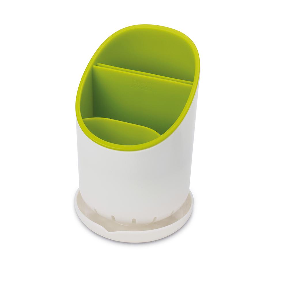 Сушилка для столовых приборов со сливом Dock зелёная. 8507485074Dock - это не просто сушилка для приборов, а умная сушилка. Обычно их сложно мыть, а также в них не предусмотрено разделение приборов и острых ножей. В сушилке Dock все эти недостатки исправлены. Для ножей есть специальное отделение, где острые лезвия высыхают безопасно и не соприкасаются с другими приборами. Излишек воды собирается в поддон, и её можно слить безо всяких проблем. Сушилка удобно разбирается для чистки. И к тому же она будет очень стильно смотреться на любой кухне.