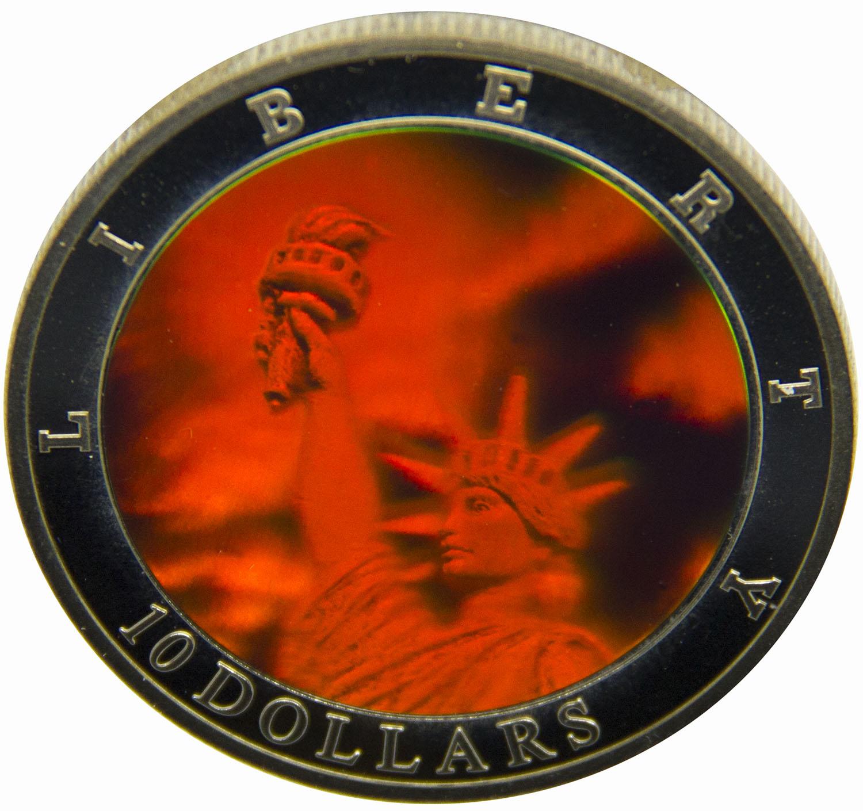 Монета номиналом 10 долларов Статуя Свободы, голограмма. Республика Либерия, 2002 год739Диаметр монеты: 40 мм Вес: 28 г. Материал: медь-никель Гурт: рубчатый